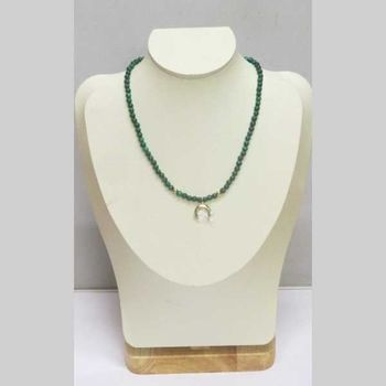 necklace with fine stones and crescent pendant
