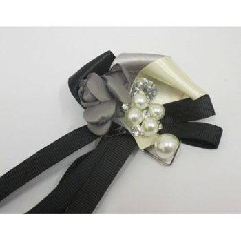 fantasy brooch with ribbon