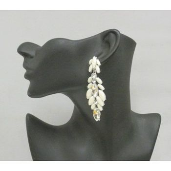 supplier in earrings that loves the Caribbean clientele