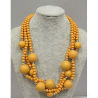 Retro necklace of yellow wooden beads
