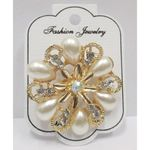 pearl flower brooch and gilded crystal