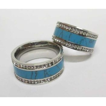 turquoise ring lined with rhinestones