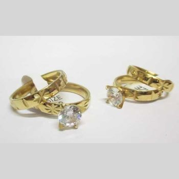 engagement ring and golden steel wedding ring set