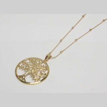 long golden tree of life necklace on dress