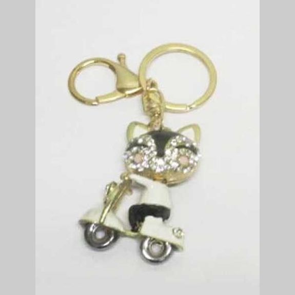 jewelry cat keychain on scooter