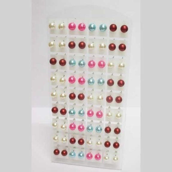 pearl earrings of all colors on plate