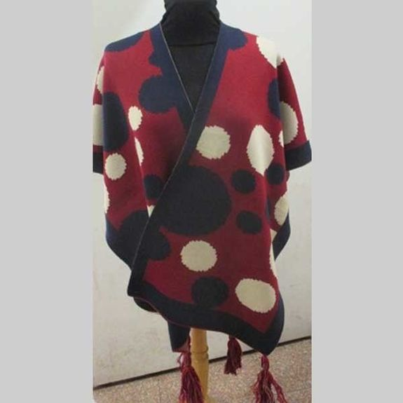 cape with pompoms