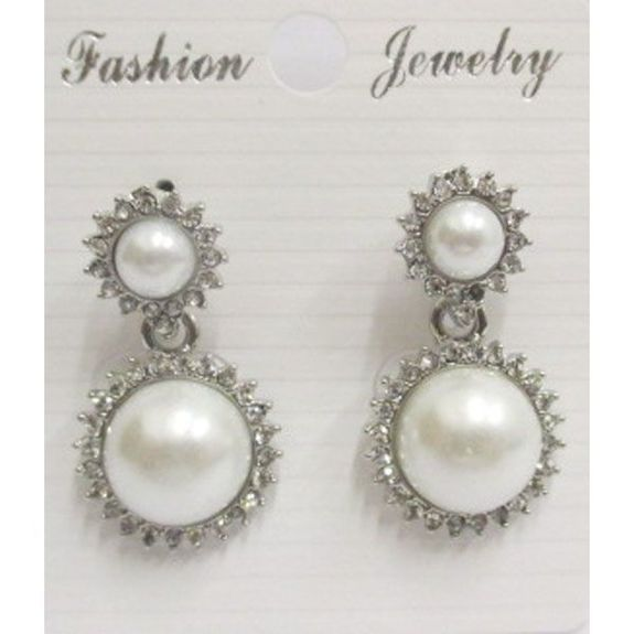 pearl earring surrounds dangling crystal