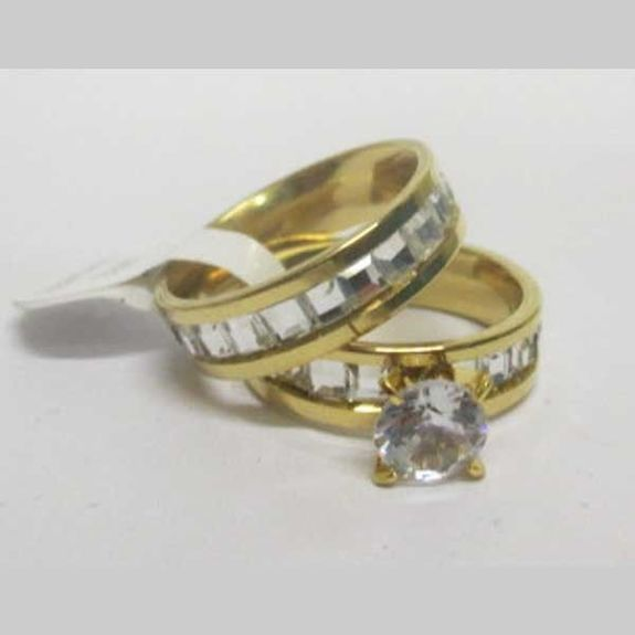 wedding ring with matching solitaire in golden steel