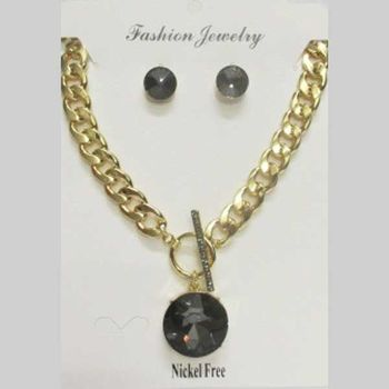 black round crystal pendant on large golden mesh chain