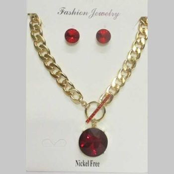red crystal pendant on large golden mesh chain