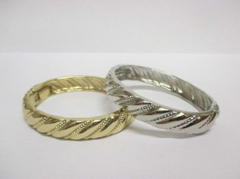 metal bangle sold in silver and gold