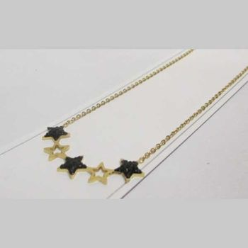 Gold and black star jewelry in steel