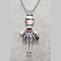doll necklace on her 31