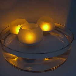 The glass ball shaped tea light holder and its LED candle - BOOL
