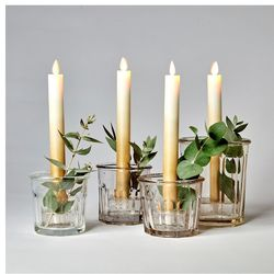Gold taper candle with moving flame