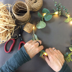 Rattan circle holder with a LED candle - wheat and eucalyptus - Ø 30 cm