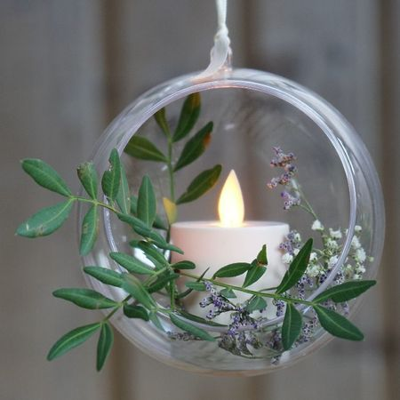 A led votive candle hung in a bubble - Gold waves
