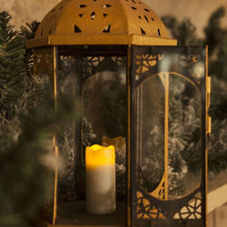 Small wax pillar led candle with a golden deer