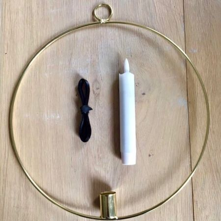 Golden circle with a LED candle