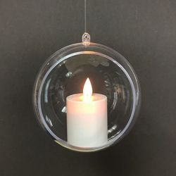 A small led moving flame candle hung in a bubble