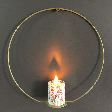 Metal holder and a LED candle with moving flame