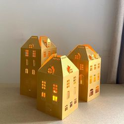 3 Golden paper house candle holders with 3 LED candles
