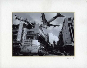 Lai Laurence An airplane landing into the Kai Tak Airport 1998.