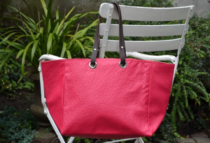Mid-size carrier bag  leather handles, ostrich, fushia