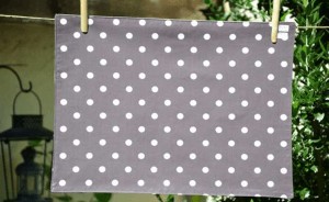Rectangular place mat, white polka-dot on dark grey ground plastified linen