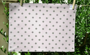 Rectangular place mat, grey polka-dot on rose ground plastified linen
