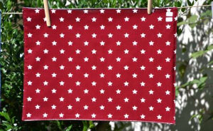 Rectangular place mat, white stars on Bordeaux ground plastified linen