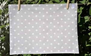 Rectangular place mat, white stars on light grey ground plastified linen