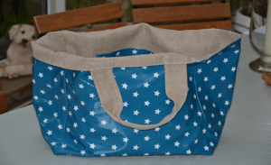 Mid-size carrier bag, white stars on turquoise blue ground plastified linen