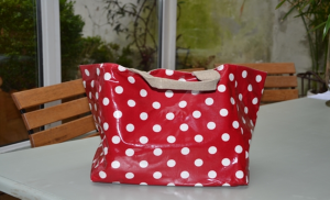 Mid-size carrier bag, large white dots on red ground plastified linen