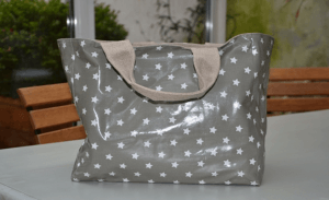 Mid-size carrier bag, white stars on grey ground plastified linen