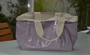 Mid-size carrier bag, white doted on plum ground plastified linen