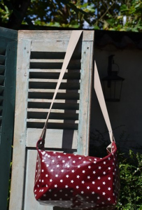 Shoulder bag, white stars on bordeaux ground plastified linen