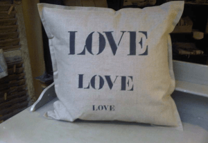 "Square cushions, black stencilled linen ""Love"