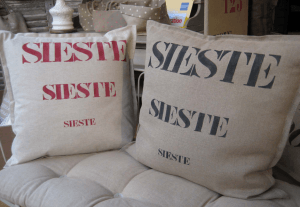 "Square cushions, red stencilled linen  ""Sieste"