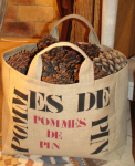 "Mid-size bag, black stencilled ""Pommes de pin"