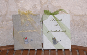 """Embroidered book A4 21x29,7 """"Semis et plantations"""" (water can)"""