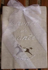 Health notebook cover   (rocking horse)(metis, ivory embroidery)