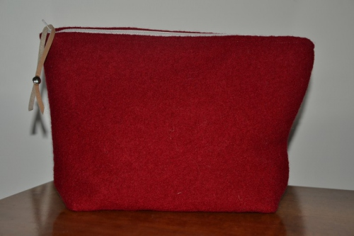 Mid-size brick red boiled wool holdall pouche