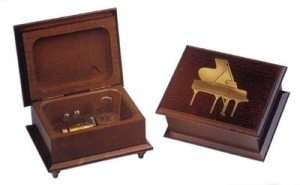 Swiss music box made of wood with an inlay made of brass a nd a traditional 18 note musical mechanism - Item # for this swiss music box : 2025501