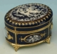Music box made of metal and porcelain with porcelain inlay and traditional 18 note musical mechanism - Item # for this music box : 23851