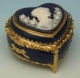 Music box made of metal and porcelain with porcelain inlay and traditional 18 note musical mechanism - Item # for this music box : 23853