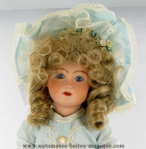 Traditional porcelain little doll made in Switzerland - Item# for this traditional porcelain little doll : POUP-01