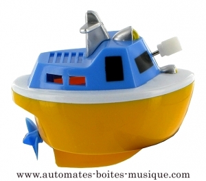 Floating boat automaton made of plastic with traditional rewind key - Item # for this floating boat automaton : 1046-JAUNE