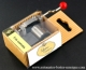 Musical mechanism in a corrugated cardboard box: hand crank musical mechanism with a red resin sphere - Item# for this hand crank musical mechanism : CORONS